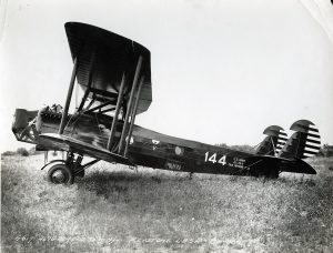 black bi-plane with bat-wing symbol